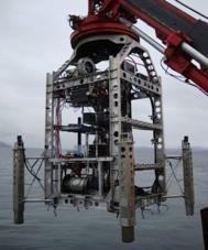 Ship-deployed seafloor drilling rig